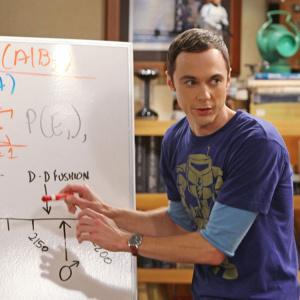 Koľko rokov mal Sheldon, keď dostal svoj prvý vysokoškolský titul Ph. D.?